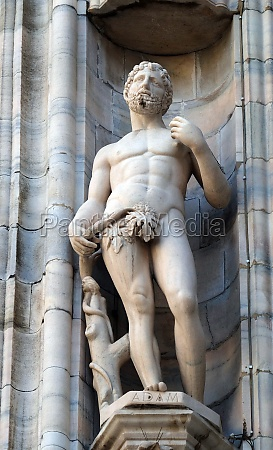 adam statue on the milan cathedral