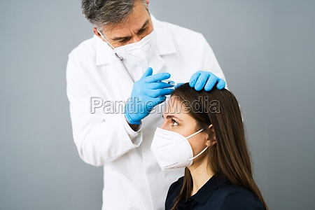 hair therapy injection by doctor using