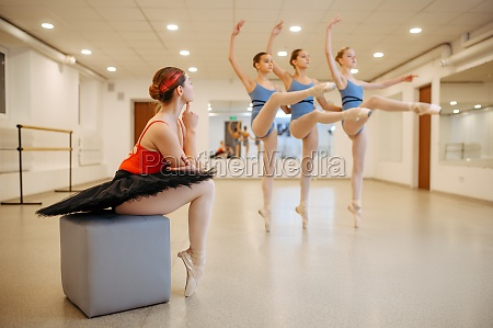 master looking on ballerinas performance in