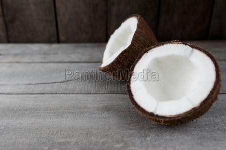 broken coconuts on gray wooden background
