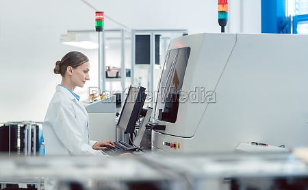 worker woman in factory operating a