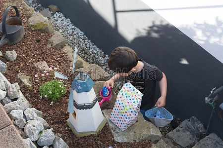 a child looking for easter egg