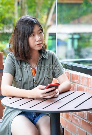 woman sitting in cafe terrace