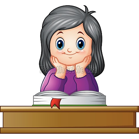 school girl with textbook at desk