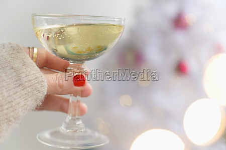 hand holding champagne glass next to