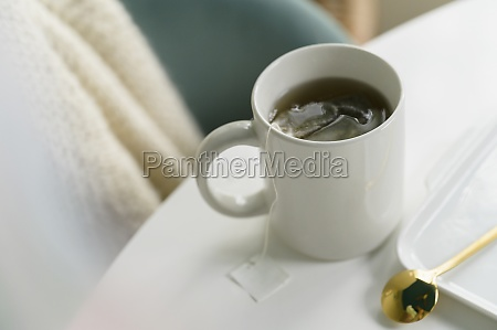 mug with tea on table