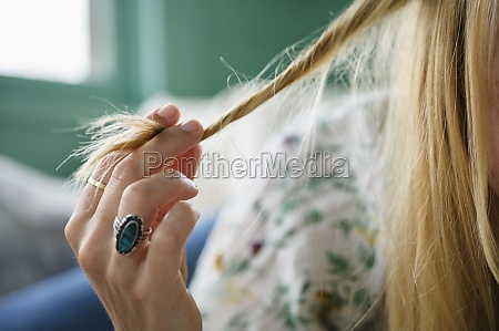 woman touching her hair close up