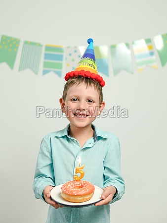 birthday donut with candle in boy