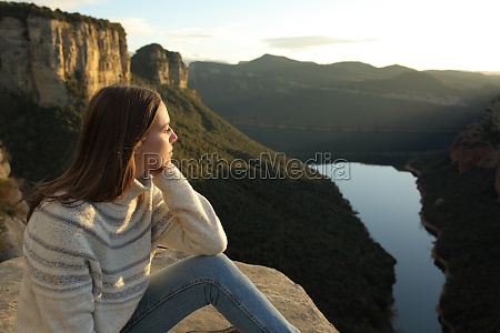 woman contemplating views in the mountain