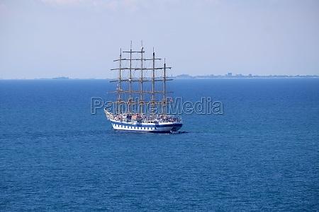 big sailboat with five masts anchored