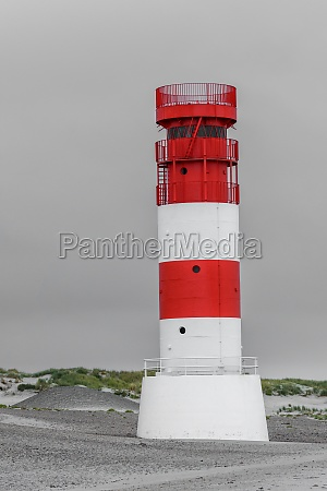 lighthouse on the dune north sea