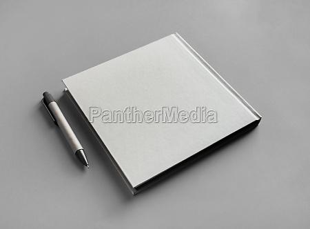 brochure and pen