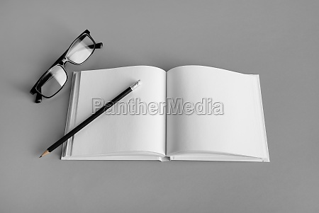 brochure pencil and glasses