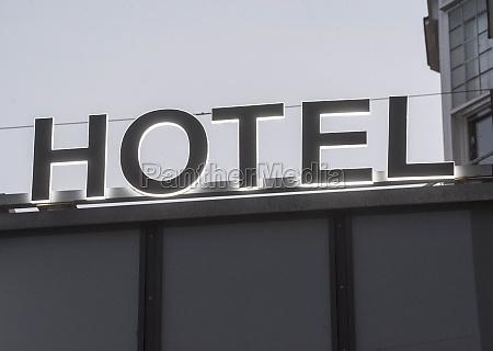 illuminated hotel sign at the entrance