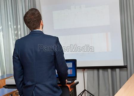 businessman shows a project
