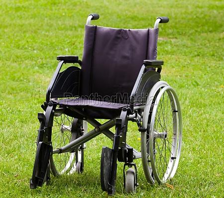 empty wheelchair on grass field