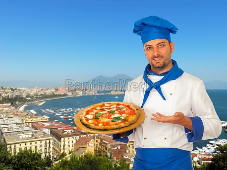 pizza maker with margherita pizza in