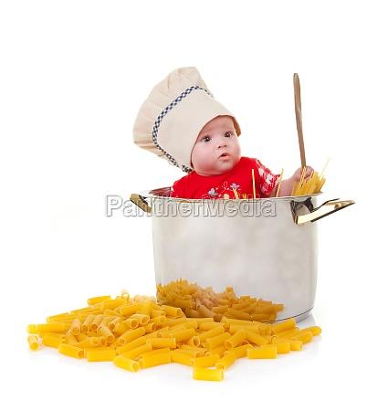 baby chef in a huge pot
