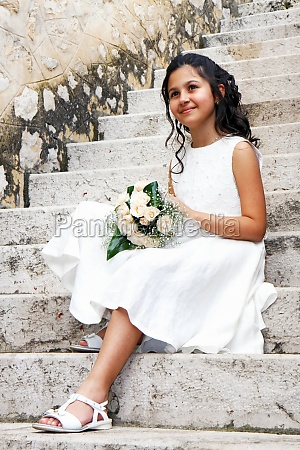 young girl in white dress for