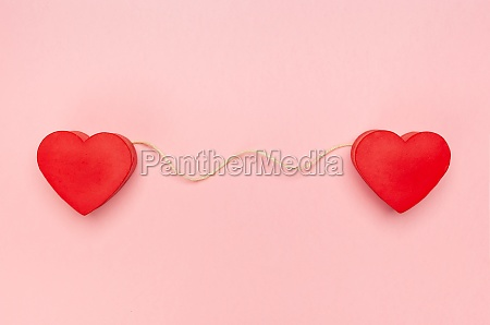 pair of red hearts connected with