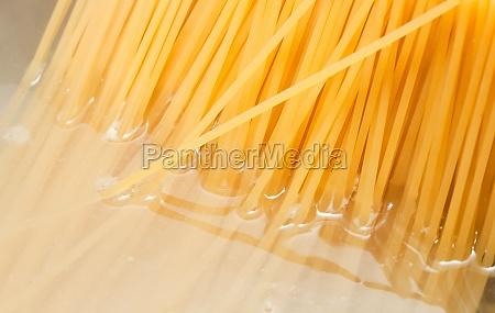 steel pot and spaghetti