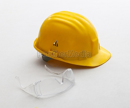 yellow helmet and glasses for safety