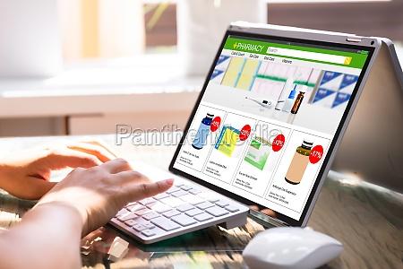 businesswoman filling survey on laptop