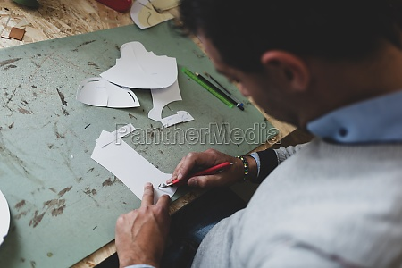 shoe designer working with paper models
