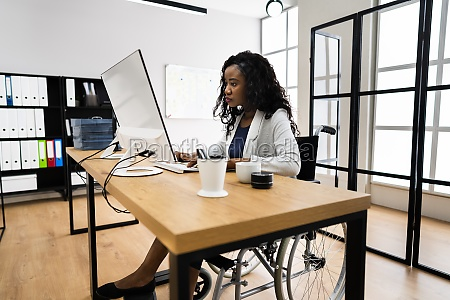 disabled african worker in wheelchair working
