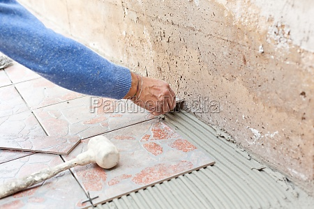 tiler works with flooring