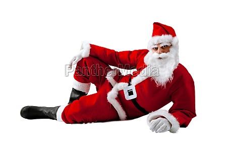 santa claus lying on a white