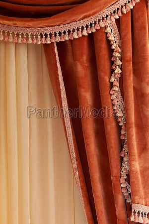 velvet curtain grape color hanging in