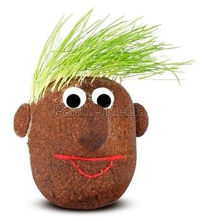 puppet with ground wheat sprouts for