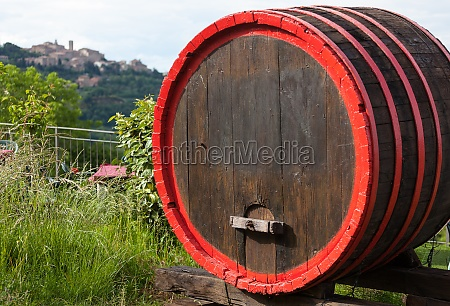 wine barrels and the hilltop town