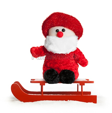 wooden red sled with santa claus