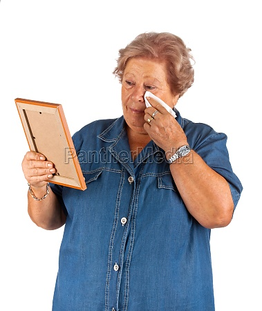 old lady crying watching a blank
