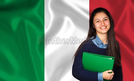 teen student smiling over italian flag