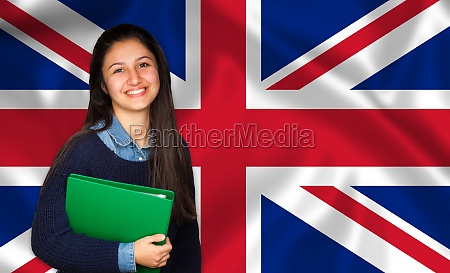 teen student smiling over english flag