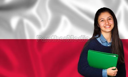 teen student smiling over polish flag