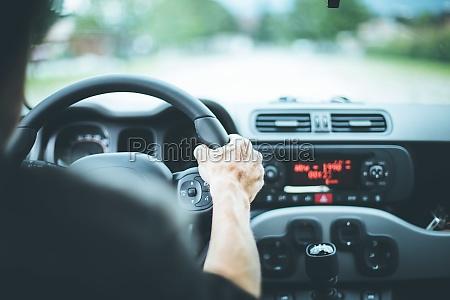 modern car interior male hands on
