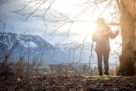 young girl enjoys the mountain view