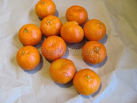 a bunch of orange juicy tangerines