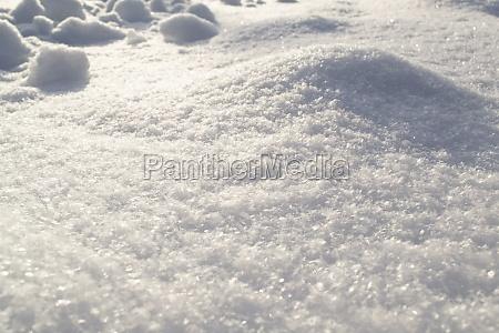 pure white snow sparkles on the