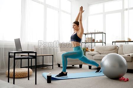 woman doing exercise online pilates training