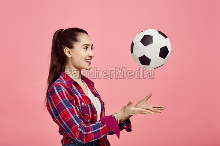 portrait of young woman with football
