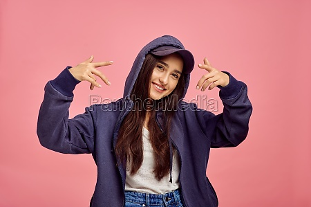 young smiling woman in hoodie pink