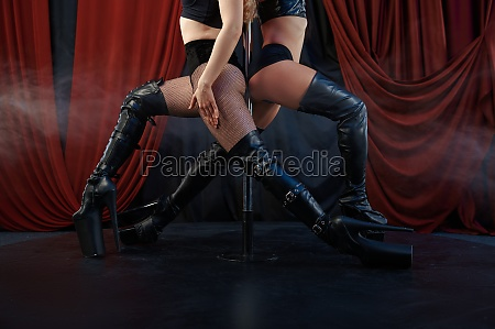 two sexy showgirls pole dance striptease