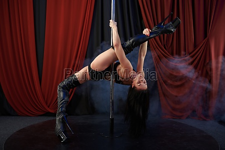 sexy showgirl with perfect stretching pole