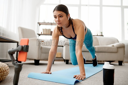 woman doing exercise on mat online