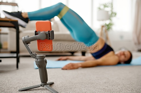 girl doing stretching exercise online training